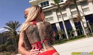 Huge titted slut with tattoos gets doggy fucked in sexy bikini
