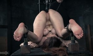 Suspended upside down bitch Bella Rossi gets her pussy punished AnySex