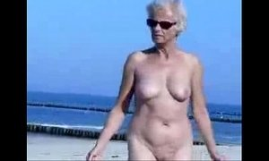 Must see this cute granny totally naked at beach xVideos