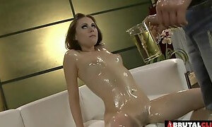 Couple and the leather couch coated in oil as they fuck