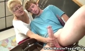 Mature teacher giving handjob to her student