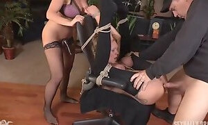 Couple plays bondage with their submissive