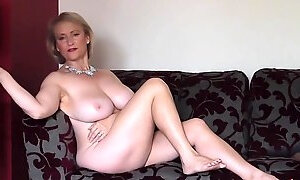 Busty chick Michelle starts stripping to reveal her round boobs
