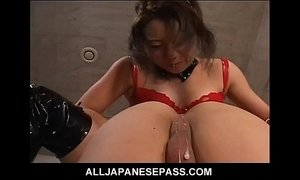 Horny Japanese MiLF in red latex with a strap on does some damage xVideos